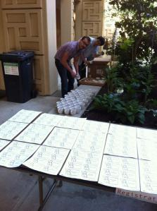 Dave and David are preparing the registration area.